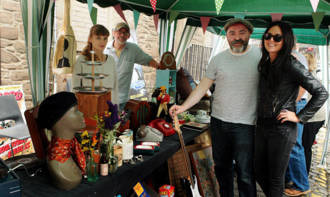 At the Johnstons Lane market, from left: Jane Gowans, Alastair Breeks Brodie of Grouchos, Richard Cook of Spex Pistols and Nicola Madill.
