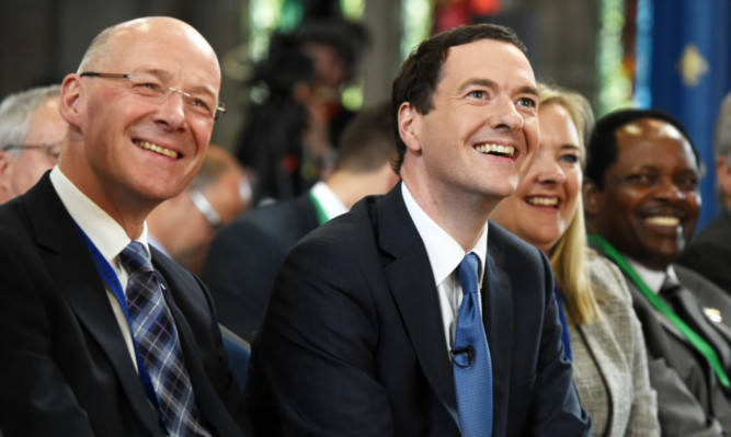 Scottish Finance Secretary John Swinney and George Osborne at the Commonwealth Games Business Conference in Glasgow.