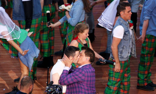 John Barrowman plants his kiss during the opening ceremony.