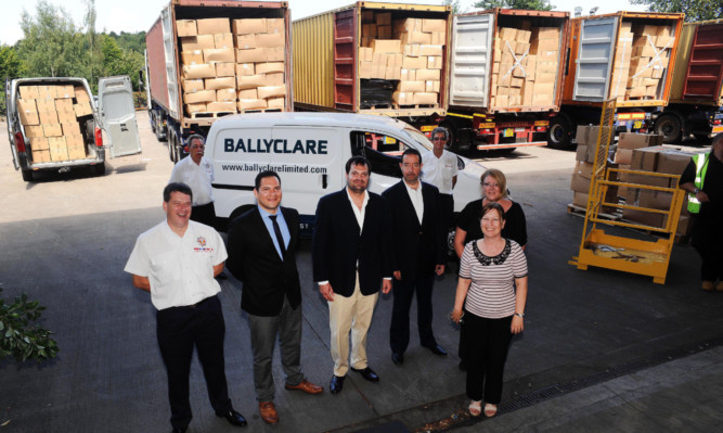 Ballyclare hands over the first batch of pallets to IFRA.