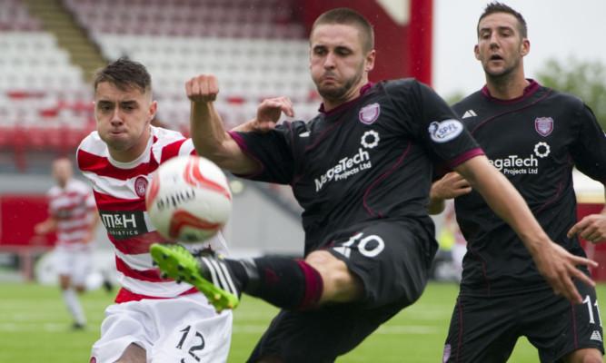 Arbroath's Mark Whatley escapes Darren Lyon's (left) efforts.