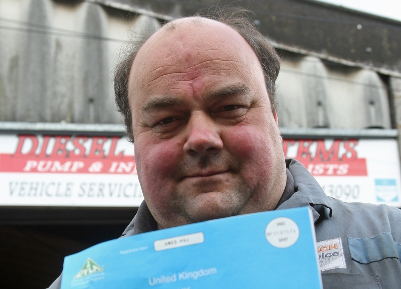 Kim Cessford, Courier - 30.04.10 - pictured with a typical car registration document that fooled him into buying a stolen car that cost him £12,000 is Gregor Lawson outside his business 'Diesel Fuel Systems' in Peddie Street