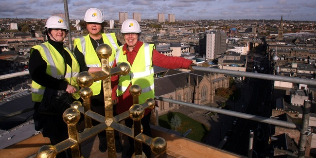 The Dundee skyline got a new addition when a cross was fitted to the top of Meadowside St Paul's church spire in the Nethergate. Minister the Rev Maudeen MacDougall (centre), congregational treasurer Morag Stalker (left) and session clerk Margaret Adamson joined workmen at the top of the 150ft-spire to see the structure being put up.