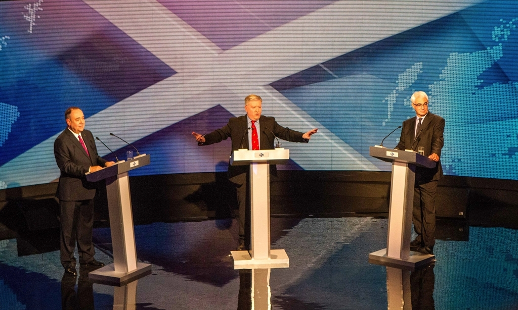 FREE FIRST USE ONLY EDITORIAL USE ONLYHandout photo issued by Devlin Photo Ltd of (left to right) Scotland's First Minister Alex Salmond, broadcast journalist Bernard Ponsonby, and former chancellor, the leader of the pro-UK Better Together campaign Alistair Darling at a TV debate of the independence referendum campaign in Glasgow. PRESS ASSOCIATION Photo. Issue date: Tuesday August 5, 2014. Broadcaster STV is staging tonight's TV showdown between the two rival politicians, with a second debate to take place on the BBC on August 25. See PA story REFERENDUM Debate. Photo credit should read: Devlin Photo Ltd/PA WireNOTE TO EDITORS: This handout photo may only be used in for editorial reporting purposes for the contemporaneous illustration of events, things or the people in the image or facts mentioned in the caption. Reuse of the picture may require further permission from the copyright holder.