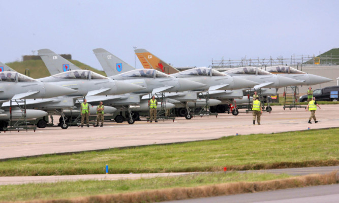 RAF Typhoons touch down at RAF Lossiemouth.