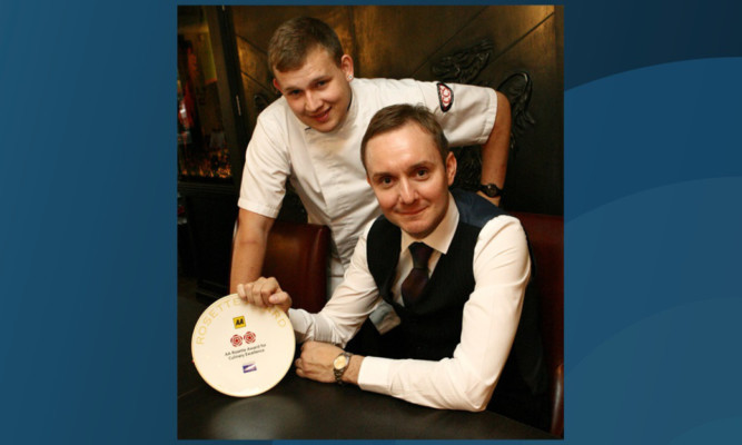 Restaurant owner Paul McMillan, seated, and head chef Adam Newth with the two AA Rosette award.