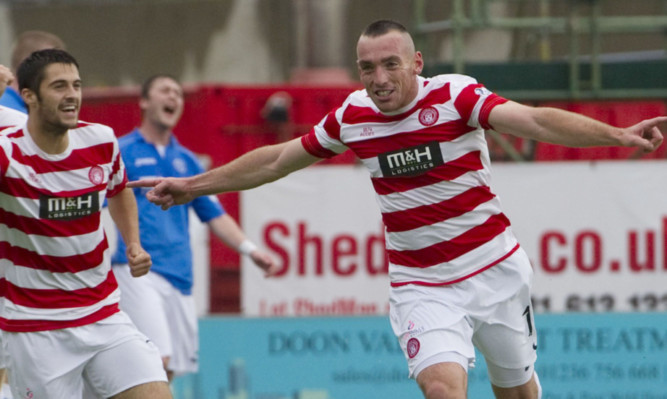 Darian MacKinnon wheels away in celebration after scoring.