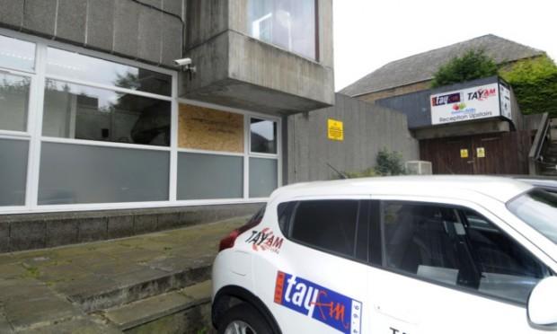 The broken window at Radio Tay.