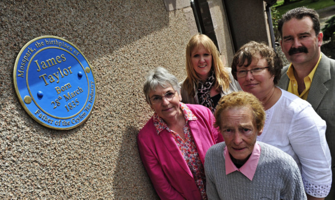 At the birthplace of James Taylor are Frances Humphreys, Jenny Thomson, Prof Angela McCarthy and Tom and Anne Lawson, who own the property.