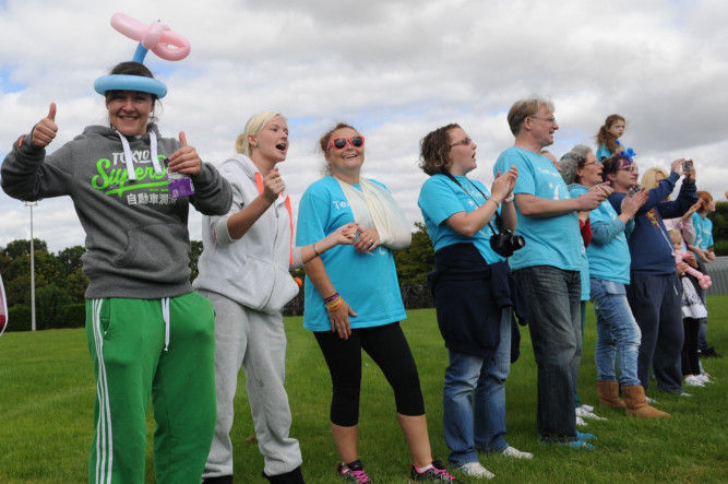More than 200 cancer survivors, their families and friends raised more than £22,000 for Cancer Research UK at the weekend through the 24-hour Relay For Life event in Dundee. The inspirational community event was opened on Saturday with an emotional lap of honour by survivors at the Ronnie McIntosh Stadium. Twenty two teams of around 200 people, including cancer survivors, spent months fundraising ahead of what was the eighth Relay For Life and made even more money on the day  with ice bucket challenges a new feature for 2014. Organisers said £22,312 was raised although another £2,000 to £3,000 is expected once the final tally is handed in.