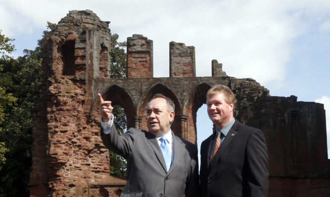 First Minister Alex Salmond with Historic Scotland's Douglas Wilson during his visit to Arbroath Abbey.