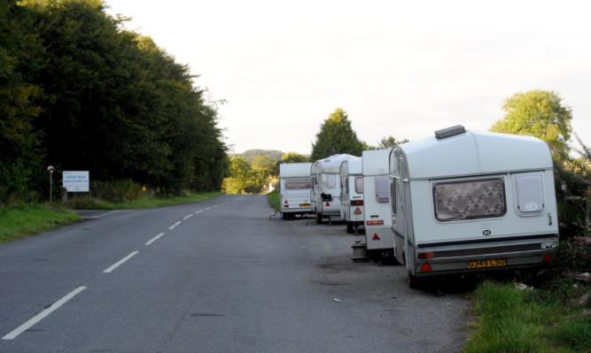 The illegal encampment of caravans in the layby opposite Balmuir Wood Travellers site.
