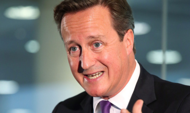 David Cameron during his visit to Scottish Widows offices in Edinburgh.