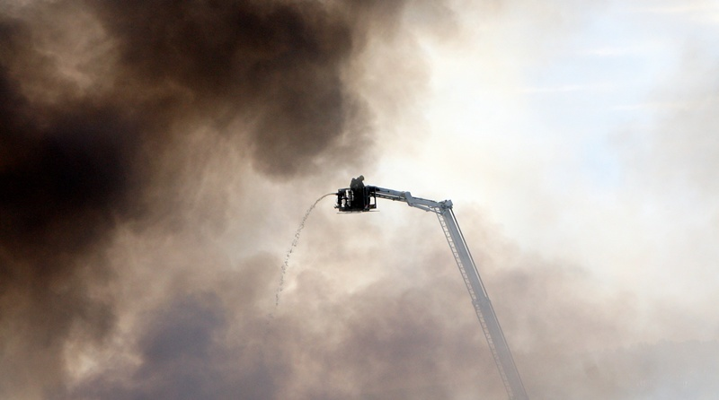 Fire at Kettle Produce, Freuchie, Fife - The thick black smoke making fighting the fire difficult for this crew