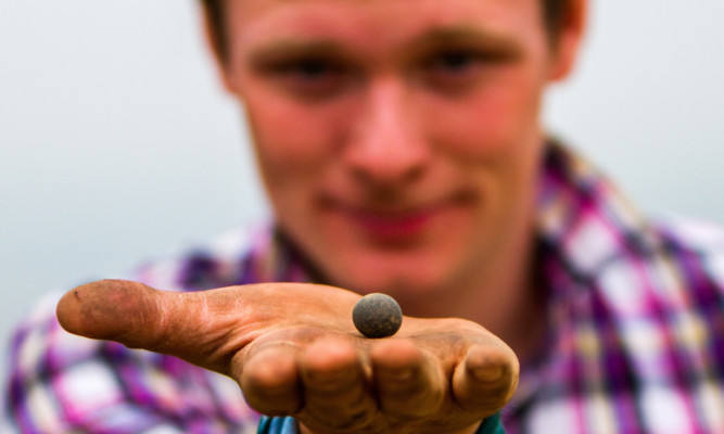 Andrew Cooper found a river pebble probably used as part of a game by the inhabitants of the fort.