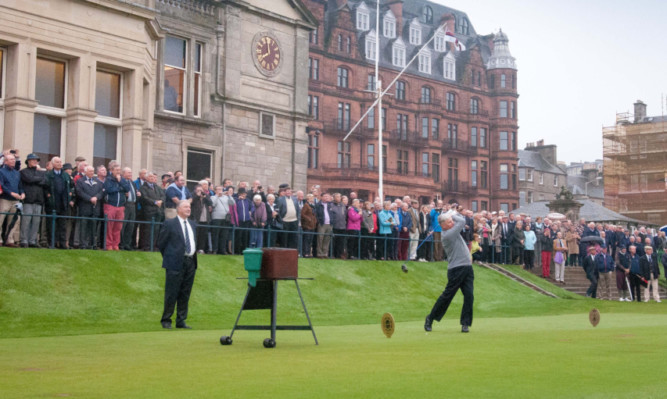 George MacGregor fires his tee-shot down the first fairway.