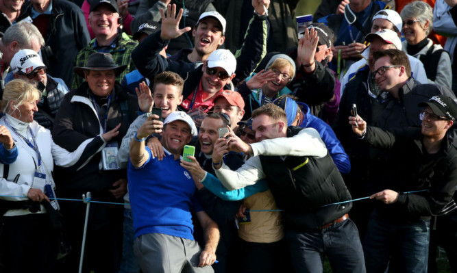Europe's Lee Westwood takes a selfie with adoring fans.