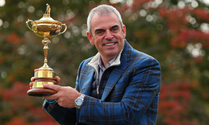 Paul McGinley with the Ryder Cup after a night celebrating at Gleneagles.