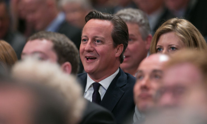 David Cameron listens to George Osborne address the party conference.