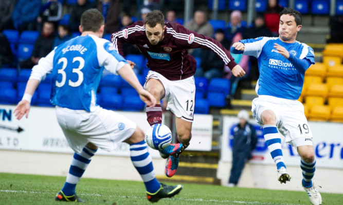 Gordon Smith is kept in check by St Johnstone's Thomas Scobbie and Gary Miller.