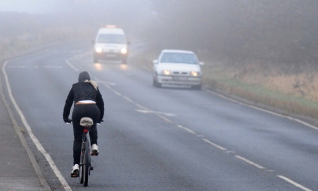 Cyclist in foggy conditions, South Derbyshire.                    . PRESS ASSOCIATION Photo. Picture date: Wednesday December 12, 2012. See PA story. Photo credit should read: Rui Vieira/PA Wire