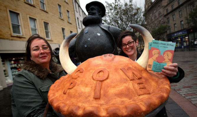 Anna Day and Peggy Hughes serve Desperate Dan up a cow pie.