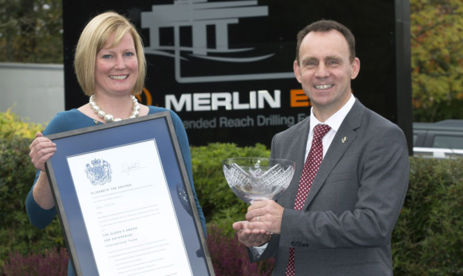 Debbie and Iain Hutchison of Merlin ERD with their Queens Award certificate and crystal bowl.
