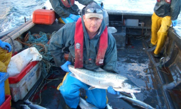 David Pullar with a Scottish wild salmon, which is to get special EU Protected Food Name status.