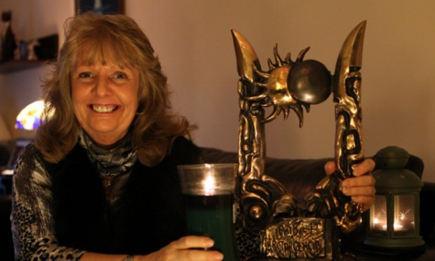 June at home with the International Battle of the Psychics trophy she won in Ukraine.