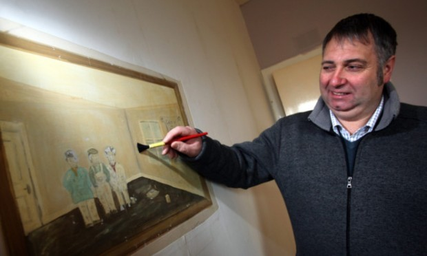 Mr Kidd brushes up a younger version of himself in the uncovered painting.