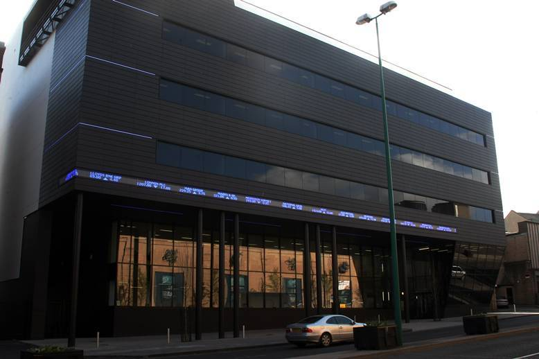 "A ticker-tape feed from the stock market on one of the city's newest buildings - the Alliance Trust corporate headquarters in West Marketgait, Dundee, features a moving readout of share prices updated on a ""live"" basis."
