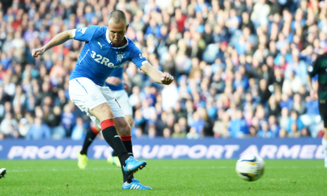 Rangers striker Kenny Miller scores his sides third goal of the game.
