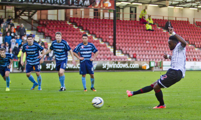 Chigozie Ugwu takes the penalty that was saved by Rab Douglas.