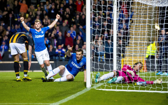 Rangers striker Jon Daly (centre) celebrates after scoring his side's opening goal of the game