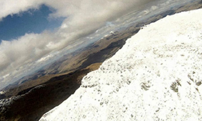 The mountain looms larger in a still image from the video released by the Air Accident Investigation Branch.