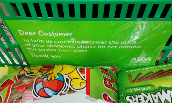 Asda makes its message to customers very clear with warning signs on its baskets.