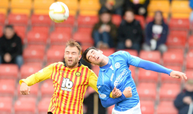 Brian Graham in an aerial battle with Partick Thistle's Conrad Balatoni.