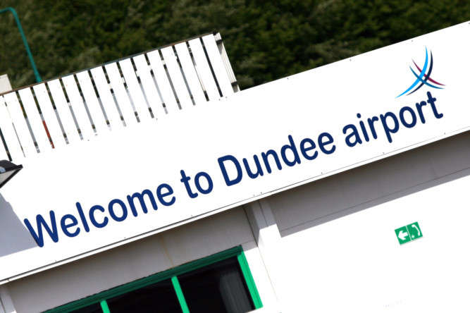 Kris Miller, Courier, 14/05/11. Picture today shows Welcome to Dundee Airport sign.
