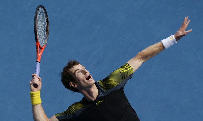 Andy Murray serves during his match against Gilles Simon.