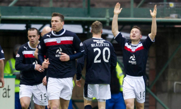 John Baird (right) celebrates after breaking the deadlock for Dundee.