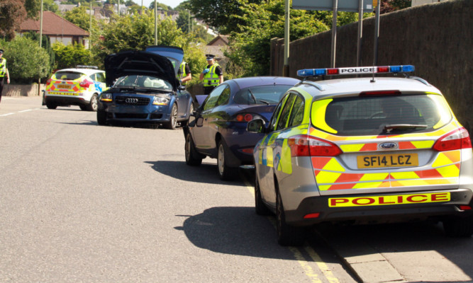 Police at the scene after the crash near the Royal Tay Yacht Club in July.