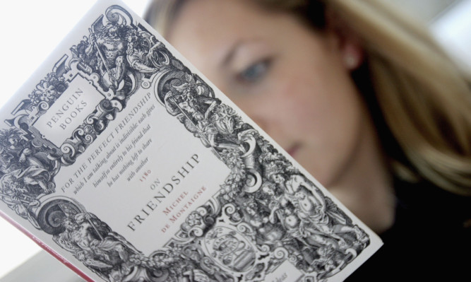 Penguin Books put in a good publishing performance, but owner Pearson announced a profits downgrade and warned of tough market conditions in the year ahead