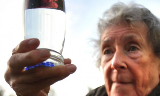 Tummel Bridge resident Maureen Robertson holds up a glass of the potentially life-threatening tap water.