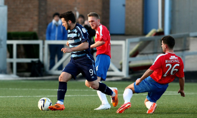 Dale Hilson takes on the Cowdenbeath defence at Station Park.