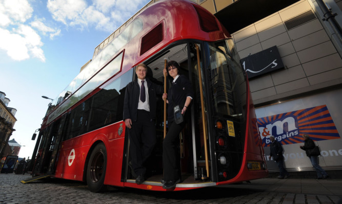 Operations supervisor Aaron McGill and conductor Issy Davidson showing the new bus in Dundee.