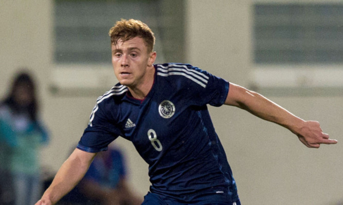 Lewis Macleod in action for Scotland Under 21s