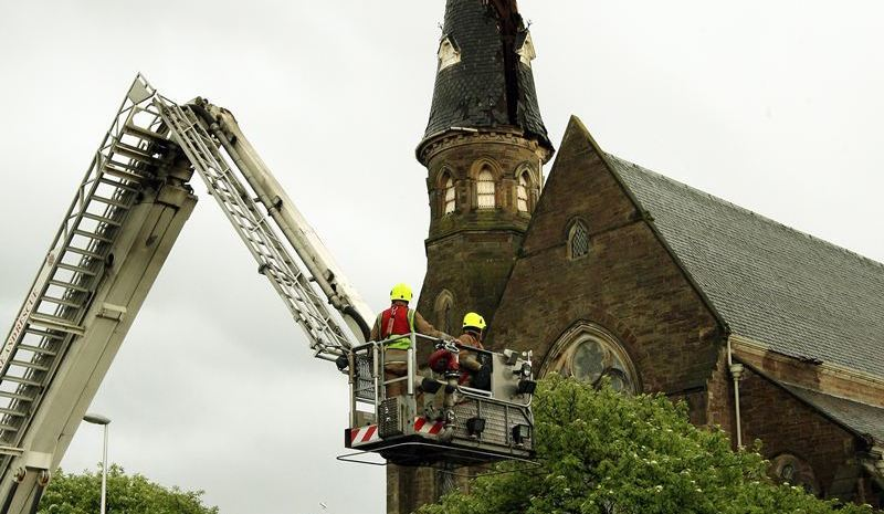 John Stevenson, Courier,27/05/10.Dundee.Broughty Ferry,Lightening Strike on steeple at St Stephen's and West Parish Church.Pic shows firefighters as they survey the damage to the steeple.