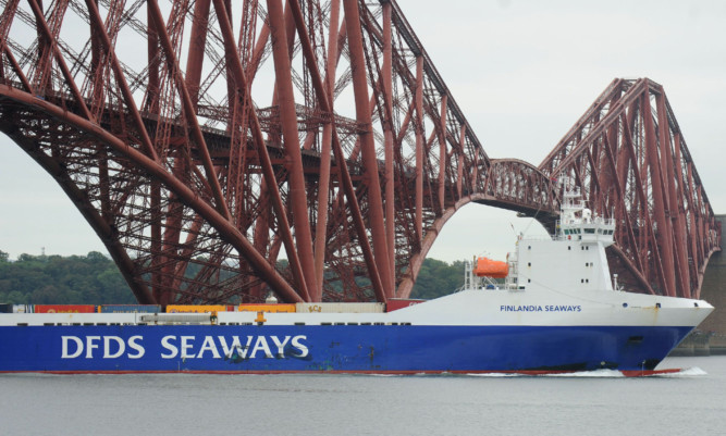 The Finlandia Seaways sails into Rosyth under the Forth Bridge.
