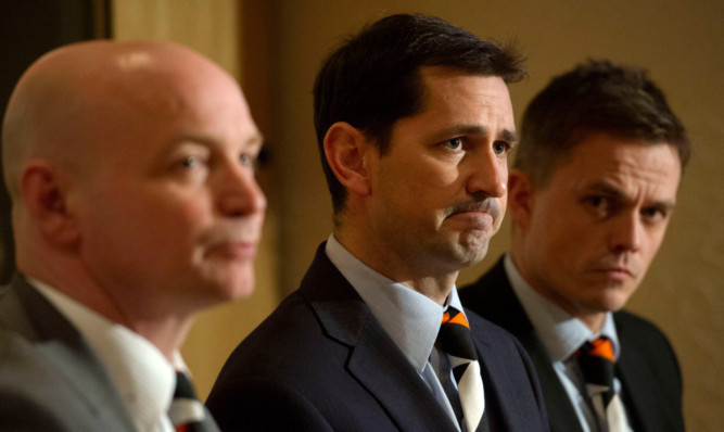 Jackie McNamara (centre) meets the media with chairman Stephen Thompson and assistant Simon Donelly.