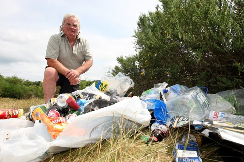 Steve MacDougall, Courier, Burnmouth Fishings, Stanley. Campers have left area in a mess. Pictured, Geordie Stewart beside some of the mess left behind by the campers.